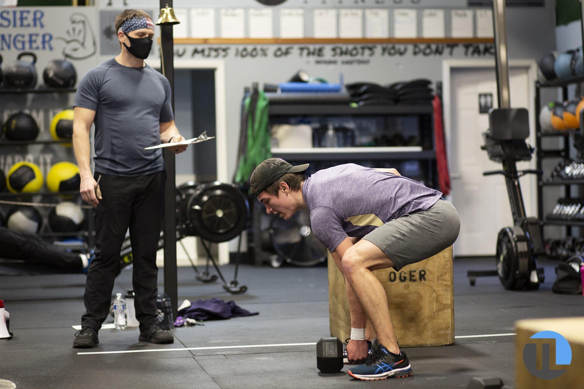 Lake Stevens personal trainer wears mask