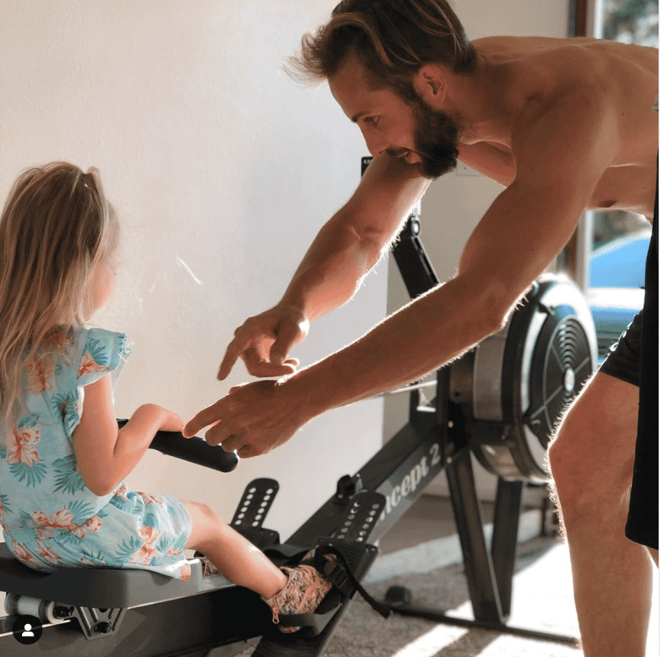 Brian Foley Teaching A Young Girl How To Row