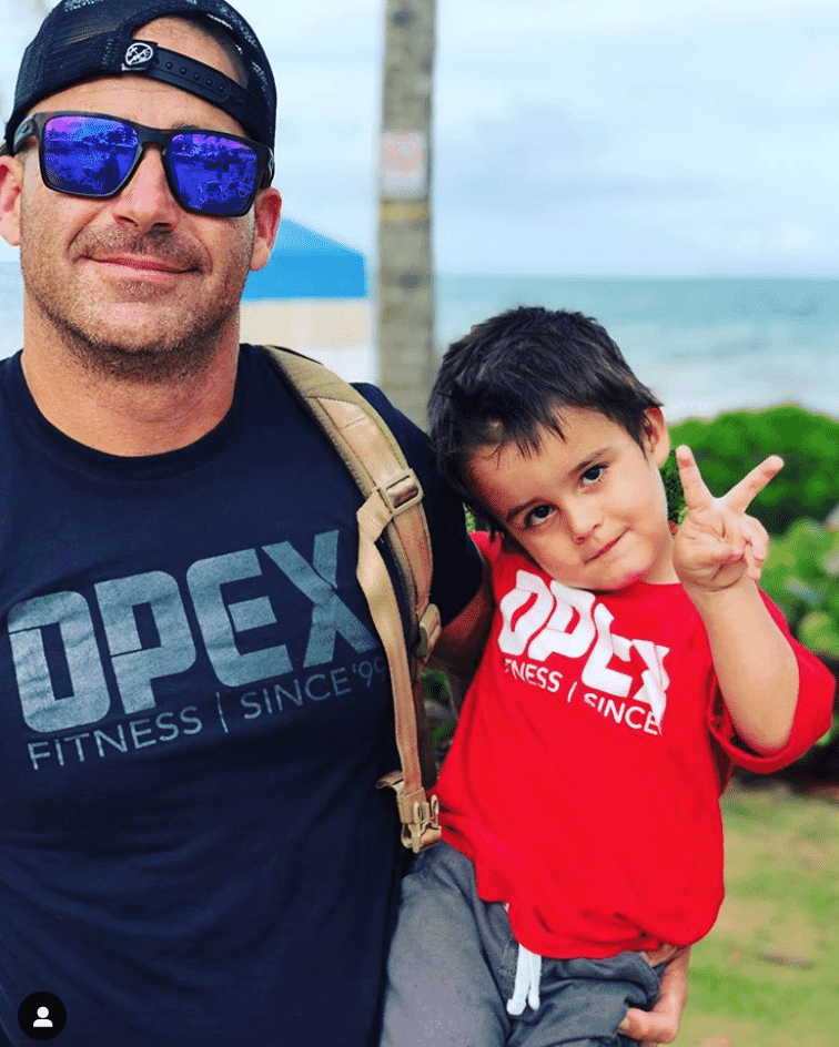 Henry Torano and his son in Puerto Rico peace sign