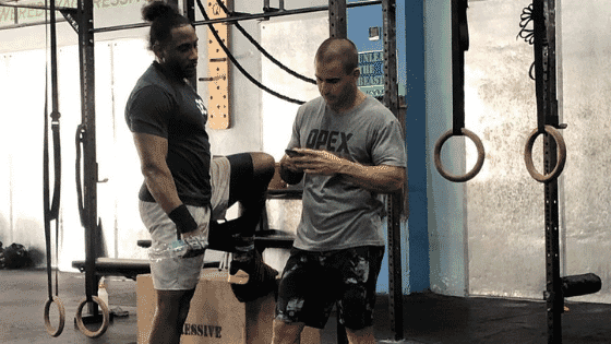 Coach Torano and athlete Yuyi Aldano discussing programming for the day